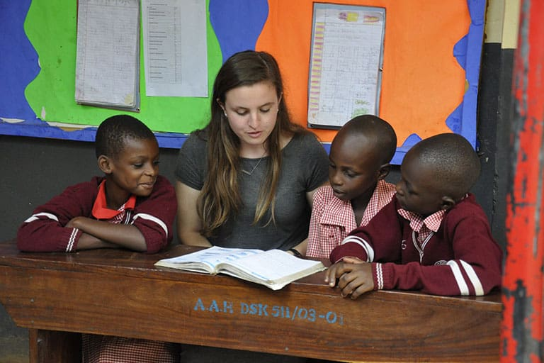 Girl volunteering at AAH Uganda
