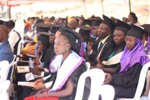 REACH graduates in robes