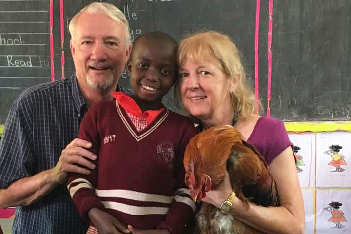 sponsors with student in uganda