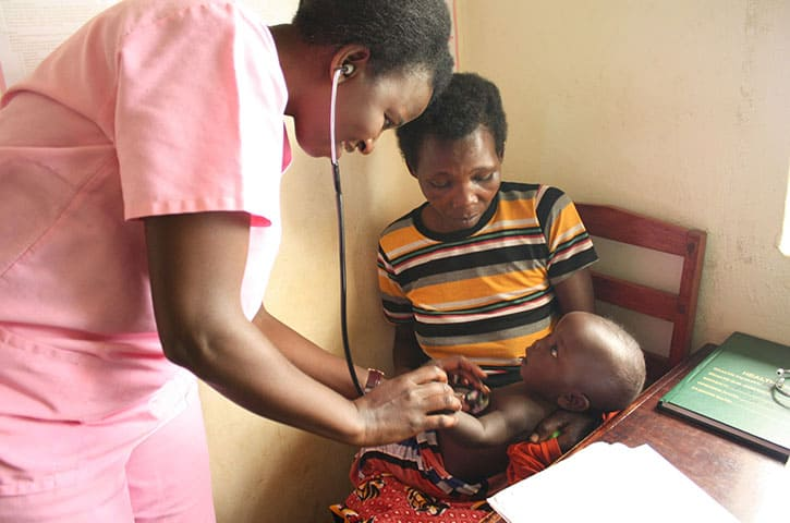 Nurse at clinic at REACH Uganda