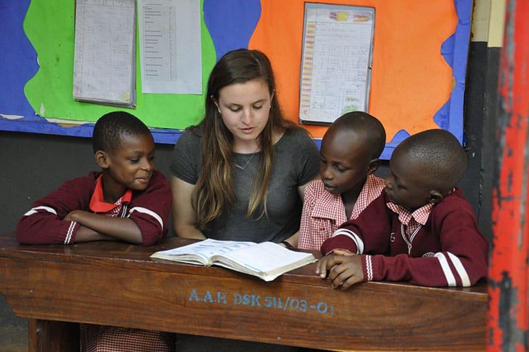Girl volunteering at REACH Uganda