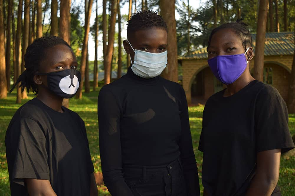 Students in Uganda with masks